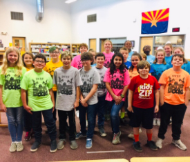 Students wearing Battle of the Books team shirts in the school library