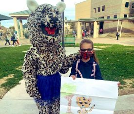 student with lenny the leopard mascot