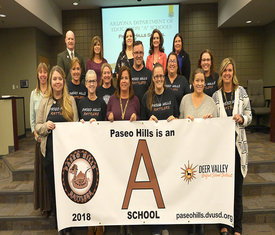 Administration and staff receive their A-rating banner