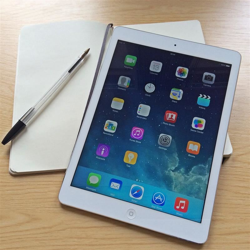 Picture of an iPad with a notebook and pen