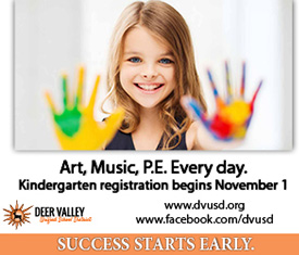 Little girl with paint on her hands advertising Kindergarten registration
