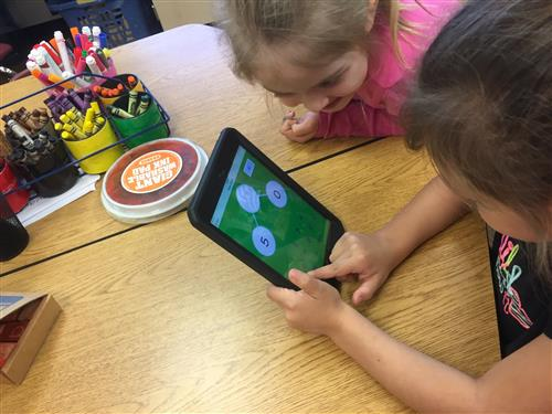 Girls Working with iPad in kindergarten class