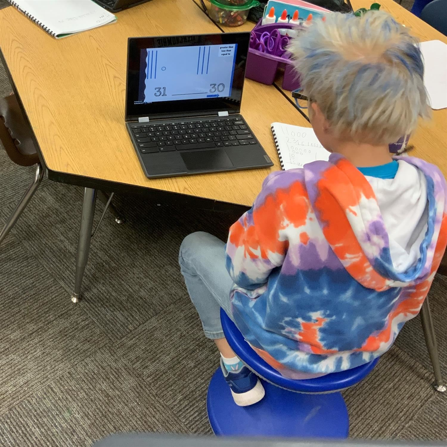 1st grade student working on math using a Chromebook