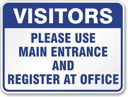 blue and white visitor sign as posted on gate