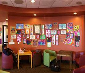Artwork from students on the wall at Elevate Coffee