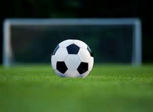 Soccer ball on field of grass